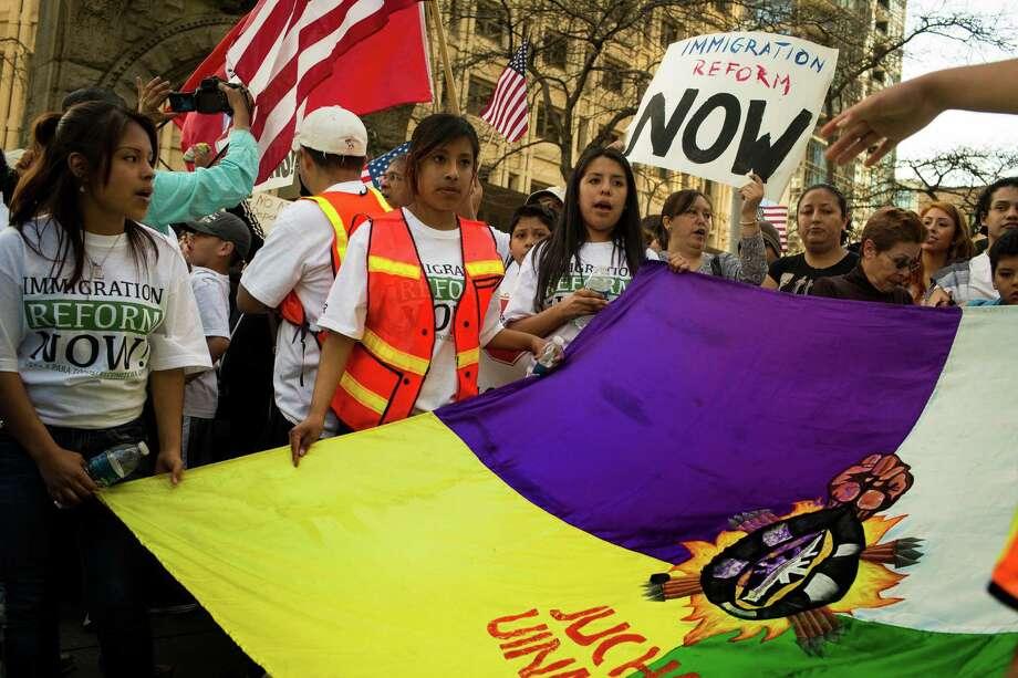Marchers gather for a rally near the federal building. Photo: JORDAN STEAD, SEATTLEPI.COM / SEATTLEPI.COM