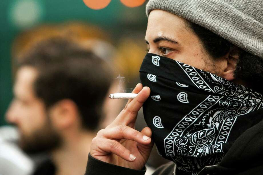 A protester smokes through a bandana. Photo: JORDAN STEAD, SEATTLEPI.COM / SEATTLEPI.COM