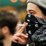 A protester smokes through a bandana.