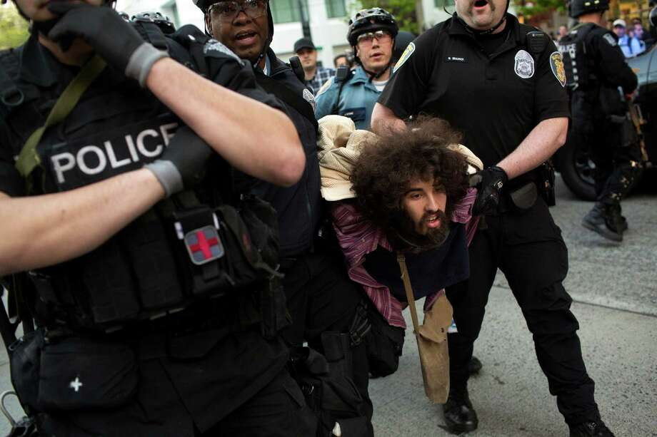 One of the first May Day-associated arrests is made at Westlake. Photo: JORDAN STEAD, SEATTLEPI.COM / SEATTLEPI.COM
