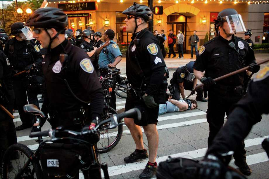 Police arrest protesters near the Paramount during the May Day riots Wednesday, May 1, 2013, in Seattle. By late evening, police reported that 18 persons had been arrested for assault and property damage. Eight police officers were hurt. Photo: JORDAN STEAD, SEATTLEPI.COM / SEATTLEPI.COM