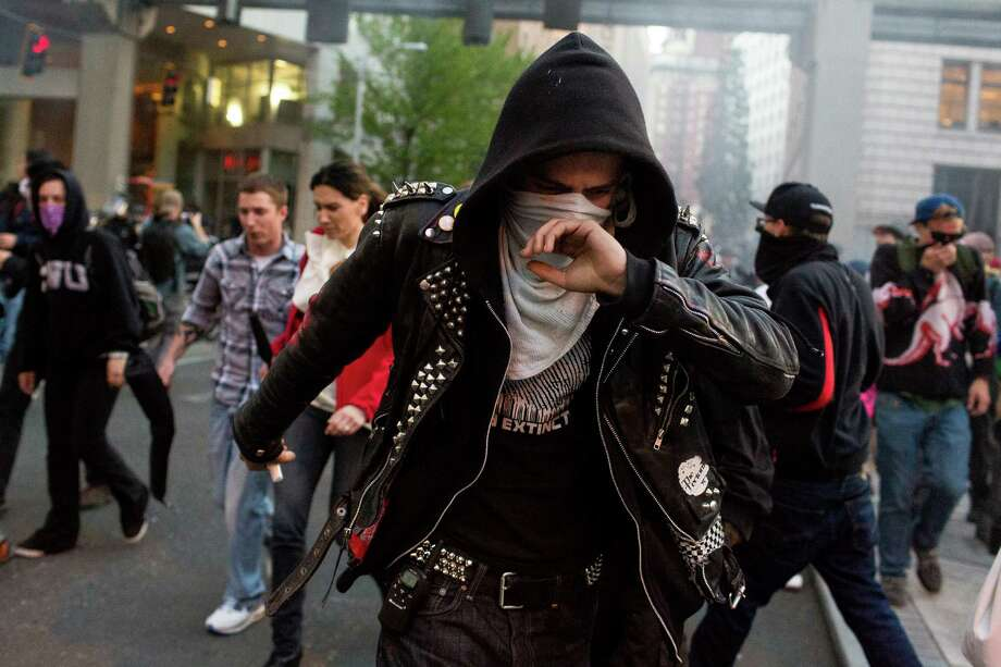 "Protesters suffer from the effects of pepper spray and ""blast balls."" Photo: JORDAN STEAD, SEATTLEPI.COM / SEATTLEPI.COM"