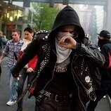"""Protesters suffer from the effects of pepper spray and """"blast balls."""""""
