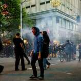 Police and protesters clash in downtown Seattle.