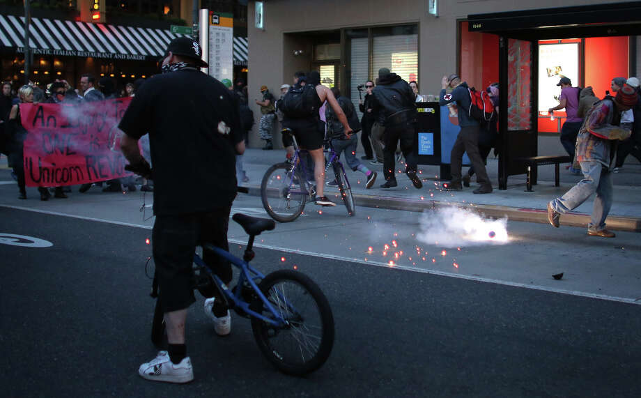 during a May Day march in downtown Seattle on Wednesday, May 1, 2013. Police aggressively responded to marchers as they blocked traffic and some threw objects at officers. Police responded with pepper spray and blast balls, firework-like devices that emit OC spray. Photo: JOSHUA TRUJILLO, SEATTLEPI.COM / SEATTLEPI.COM