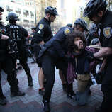 A man is arrested during a May Day march in downtown Seattle near Westlake Park.