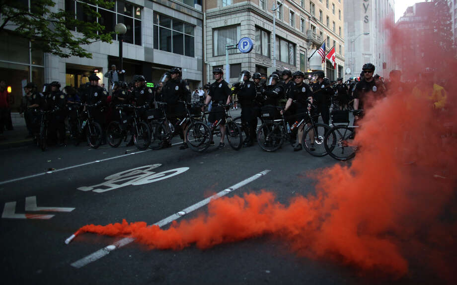 Officers form a line near Westlake Mall during a May Day march in downtown. Police aggressively responded to marchers as they blocked traffic and some threw objects at officers and broke windows. Police responded with pepper spray and blast balls, firework-like devices that emit a puff of pepper. Photo: JOSHUA TRUJILLO, SEATTLEPI.COM / SEATTLEPI.COM