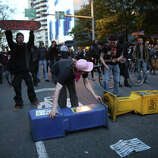 Protesters attempt to set up a barricade on Pine Street.