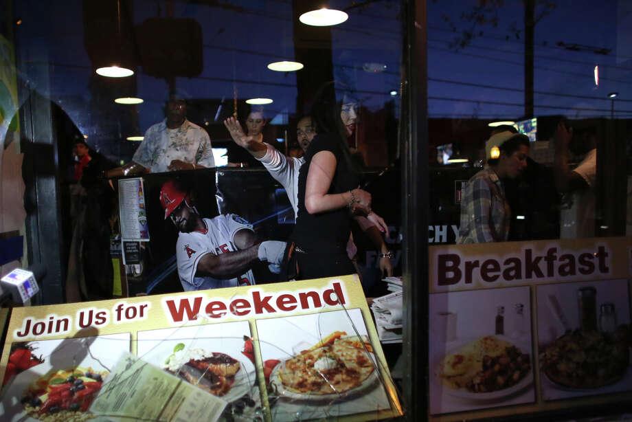 People inside Bill's Off Broadway react after a window was smashed. Photo: JOSHUA TRUJILLO, SEATTLEPI.COM / SEATTLEPI.COM
