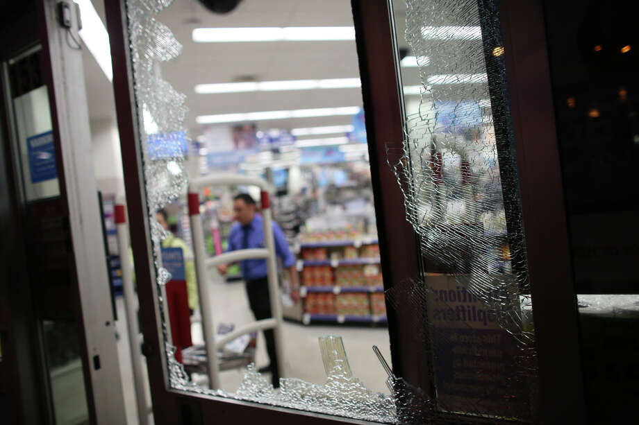 A smashed window is shown at a Walgreen's store in Capitol Hill during a May Day march in downtown Seattle on Wednesday, May 1, 2013. Police aggressively responded to marchers as they blocked traffic and some threw objects at officers. Police responded with pepper spray and blast balls, firework-like devices that emit OC spray. Photo: JOSHUA TRUJILLO, SEATTLEPI.COM / SEATTLEPI.COM