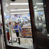A smashed window is shown at a Walgreen's store in Capitol Hill on Broadway and East Pine Street.