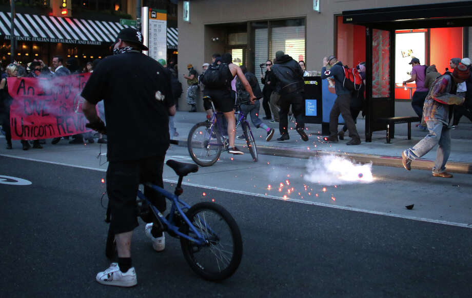 A blast ball rolls through protesters before it exploded during a May Day march in downtown Seattle on Wednesday, May 1, 2013. Police aggressively responded to marchers as they blocked traffic and some threw objects at officers. Police responded with pepper spray and blast balls, firework-like devices that emit OC spray. Photo: JOSHUA TRUJILLO, SEATTLEPI.COM / SEATTLEPI.COM
