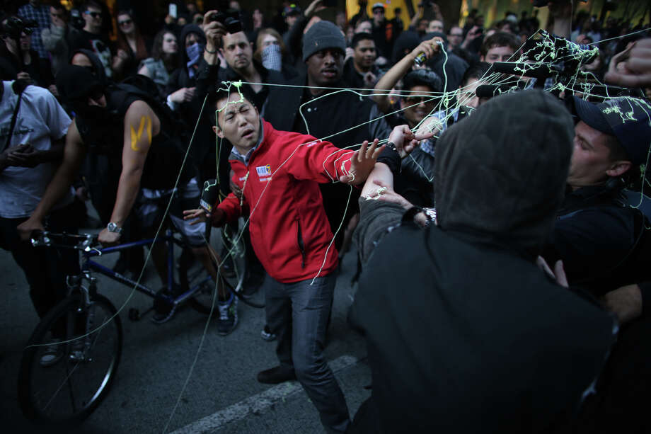KIRO/7 reporter David Ham is covered with silly string during a May Day march in downtown Seattle on Wednesday, May 1, 2013. Police aggressively responded to marchers as they blocked traffic and some threw objects at officers. Police responded with pepper spray and blast balls, firework-like devices that emit OC spray. Photo: JOSHUA TRUJILLO, SEATTLEPI.COM / SEATTLEPI.COM