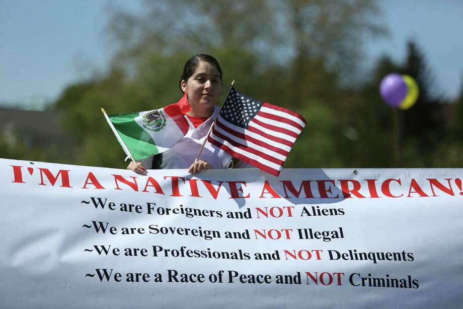 Astrid Velazco, 19, of Tijuana holds a banner. She immigrated to the US when she was 12 but has been here on an expired visa for the last four years. She hopes to go to college to become an art teacher through the Dream act. Photo: JOSHUA TRUJILLO, SEATTLEPI.COM / SEATTLEPI.COM