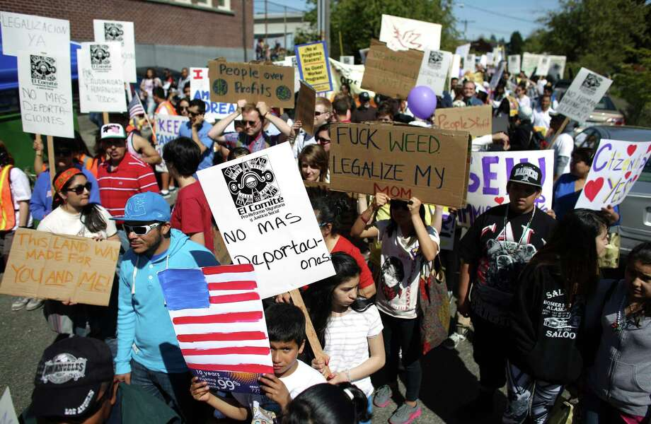 Participants march during an immigrant rights May Day rally. Photo: JOSHUA TRUJILLO, SEATTLEPI.COM / SEATTLEPI.COM