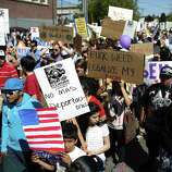 Participants march during an immigrant rights May Day rally.