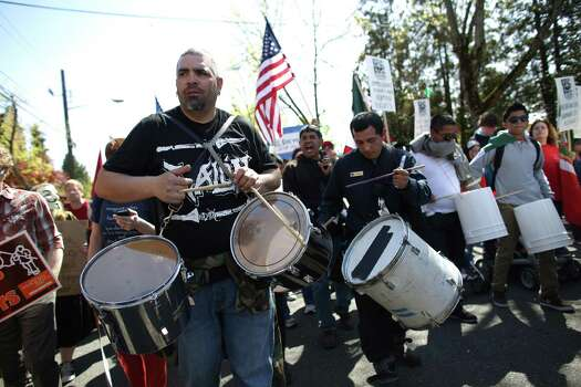 Participants play drums during an immigrant rights May Day rally. Photo: JOSHUA TRUJILLO, SEATTLEPI.COM / SEATTLEPI.COM