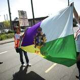 Participants hoist a flag during an immigrant rights May Day rally.
