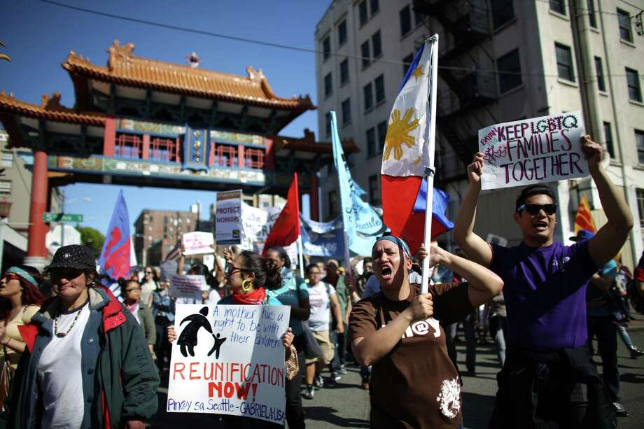 People march through the International District. Photo: JOSHUA TRUJILLO, SEATTLEPI.COM / SEATTLEPI.COM