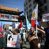 People march through the International District.