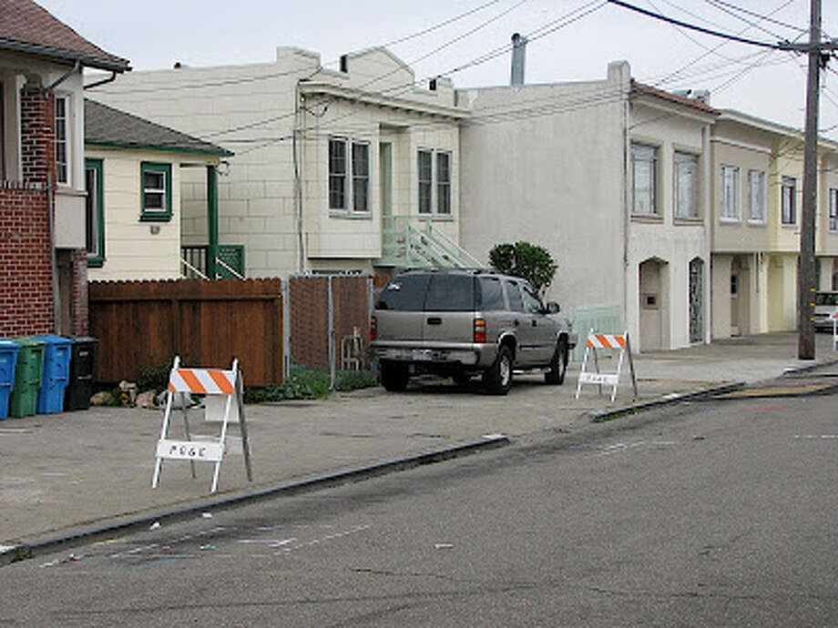 Construction on the roads can eliminate whole blocks of parking spaces for months. Too bad. You can't park on the sidewalk. Photo via San Francisco Department of Sidewalk Parking blog