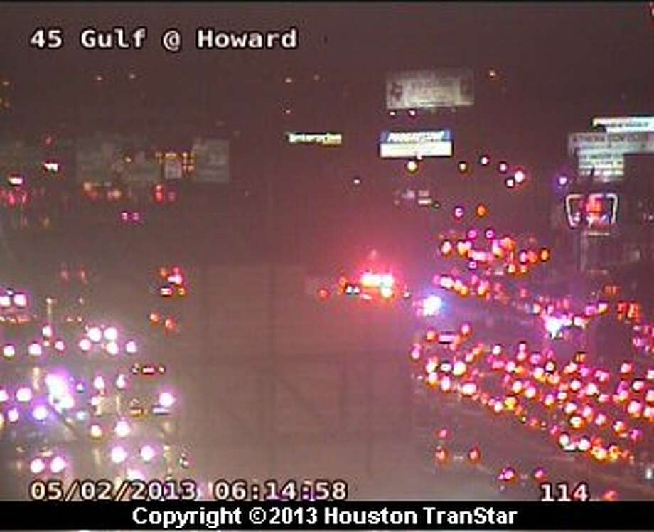 Traffic was slowed on the Gulf Freeway in southeast Houston after a police officer riding a motorcycle was involved in a crash early Thursday morning. Photo: Houston Transtar