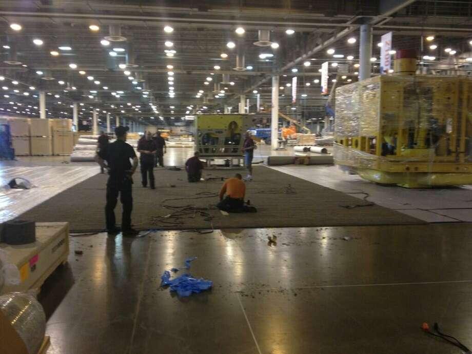 @OTCHouston via Twitter: Workers hard at work setting up the Reliant Center exhibit floor! #OTCHOUSTON
