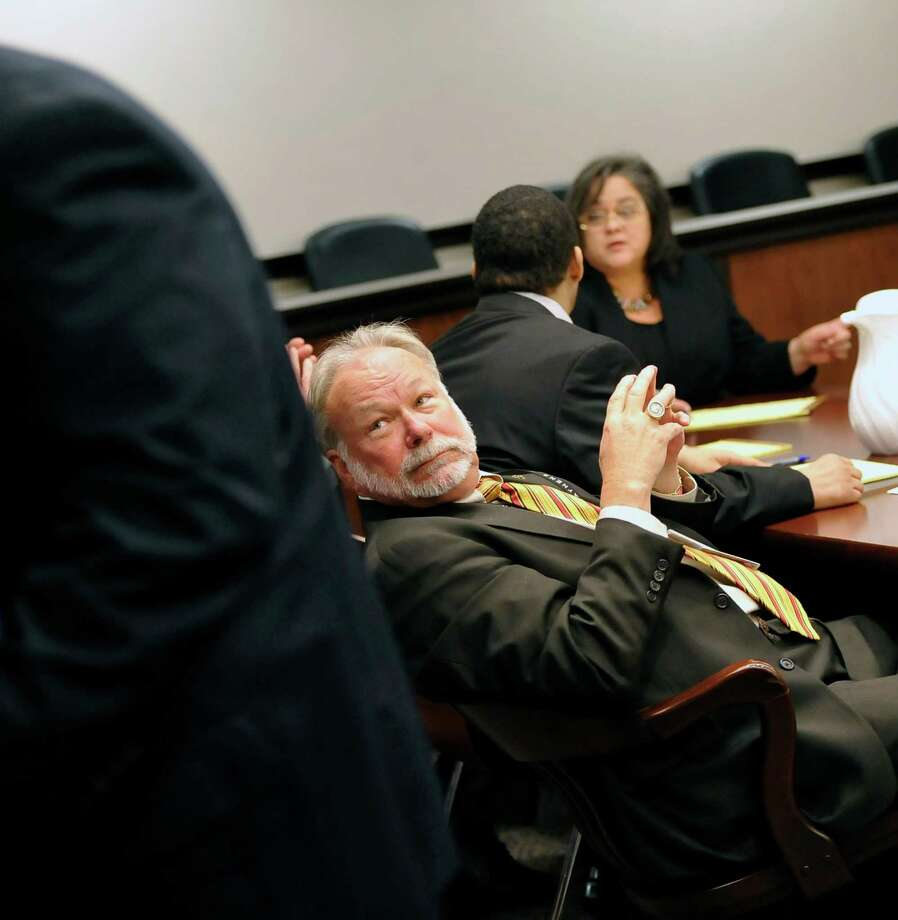 While waiting for the judge, who was asking the media with cameras to please leave the courtroom, James Makin, one of the defendant's attorneys, turns around to watch. Testimony has begun today in Galveston in the relocated capital murder trial of  Granger, who is on trial in the shooting death of Minnie Ray Sebolt, a 79-year-old Deweyville resident who was gunned down March 14, 2012, at the Jefferson County Courthouse. According to his indictment, Granger was trying to shoot a witness in an aggravated sexual assault trial in which he was the defendant and accidentally hit Sebolt. The crime is capital murder because Sebolt was killed in the commission of another crime, retaliation against a witness, according to the prosecution.    Dave Ryan/The Enterprise Photo: Dave Ryan