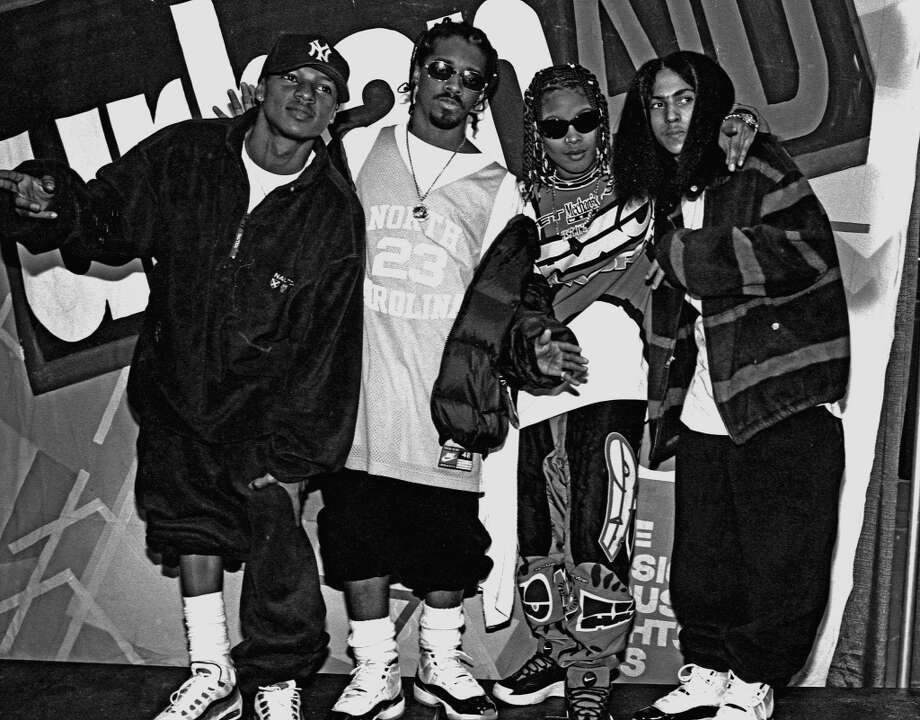 "Kriss Kross (Chris ""Mac Daddy"" Kelly and Chris ""Daddy Mac"" Smith), Jermaine Dupri and Da Brat (born Shawntae Harris) pose for a photo backstage at Madison Square Garden after Lifebeat's Urban Aid benefit concert on October 5, 1995 in New York City, New York. (Photo by Catherine McGann/Getty Images)"