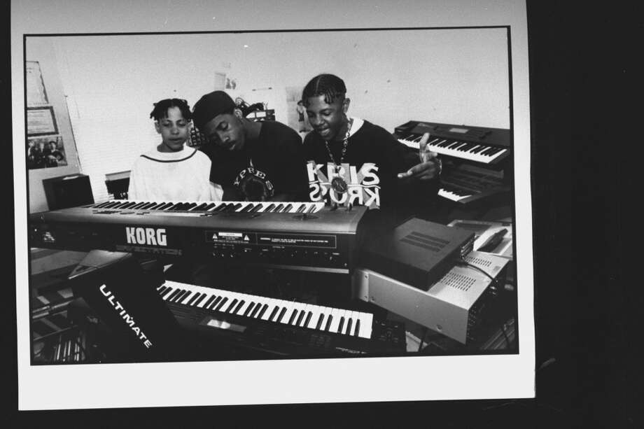 (L-R) Kris Kross rap duo Daddy Mack (Chris Smith) & Mack Daddy (Chris Kelly) watch their manager Jermaine Dupris, who is playing Korg electronic keyboard in his home recording studio. (Photo by Acey Harper//Time Life Pictures/Getty Images)
