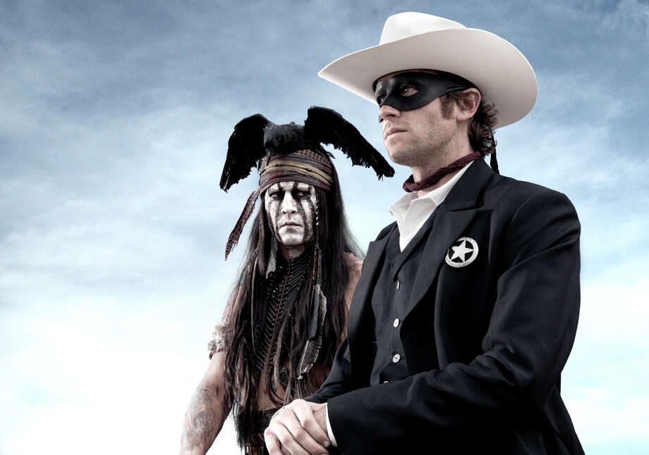 """FILE - An undated publicity photo released by Disney/Bruckheimer Films, shows actors, Johnny Depp, left, as Tonto, a spirit warrior on a personal quest, who joins forces in a fight for justice with Armie Hammer, as John Reid, a lawman who has become a masked avenger in the film, 'The Lone Ranger."""" With the summer movie season now beginning in May, studios are co-opting the pop-culture convention's model of stoking interest in anticipated films by bringing sneak-peeks of new material directly to super fans. Johnny Depp and Armie Hammer took questions from fans at """"The Lone Ranger"""" event in Las Vegas in a segment streamed live online. The film releases July 3, 2013. Photo: Disney/Bruckheimer Films, Peter Mountain"""