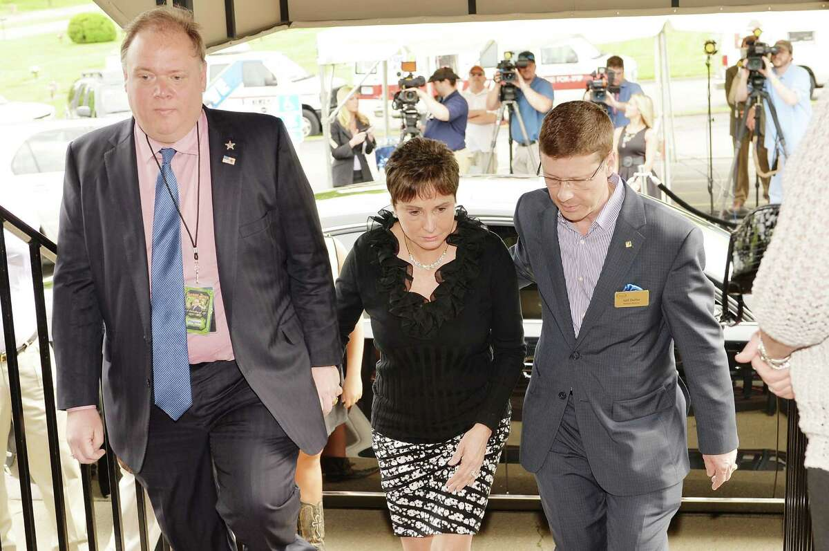 Nancy Jones (C) is escorted into the private visitation for George Jones on May 1, 2013 in Nashville, Tennessee. Jones passed away on April 26, 2013 at the age of 81.