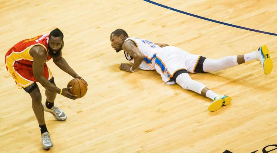 Rockets shooting guard James Harden scoops up a turnover by Thunder small forward Kevin Durant.
