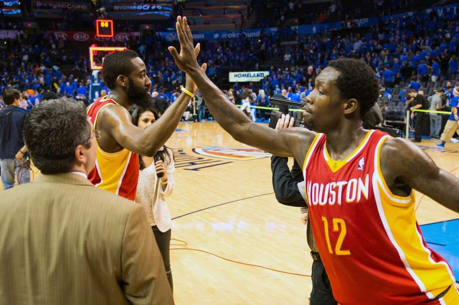 James Harden and Patrick Beverley celebrate following the victory.