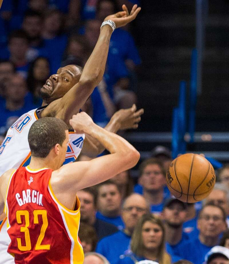 Rockets guard Francisco Garcia knocks the ball away from Thunder forward Kevin Durant.
