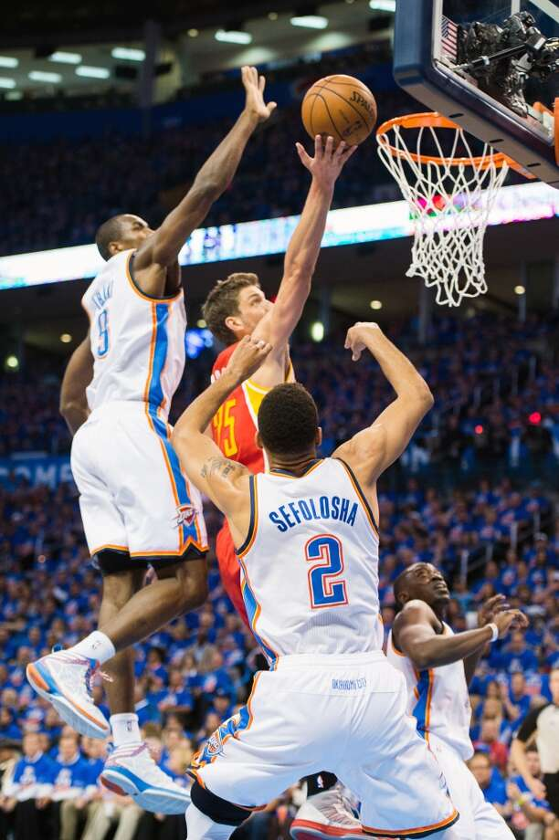 Rockets small forward Chandler Parsons shoots past Thunder power forward Serge Ibaka.