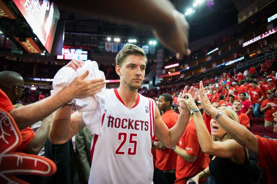 April 29: Rockets 105, Thunder 103 Rockets forward Chandler Parsons celebrates with fans after the victory. Thunder lead best-of-seven series 3-1