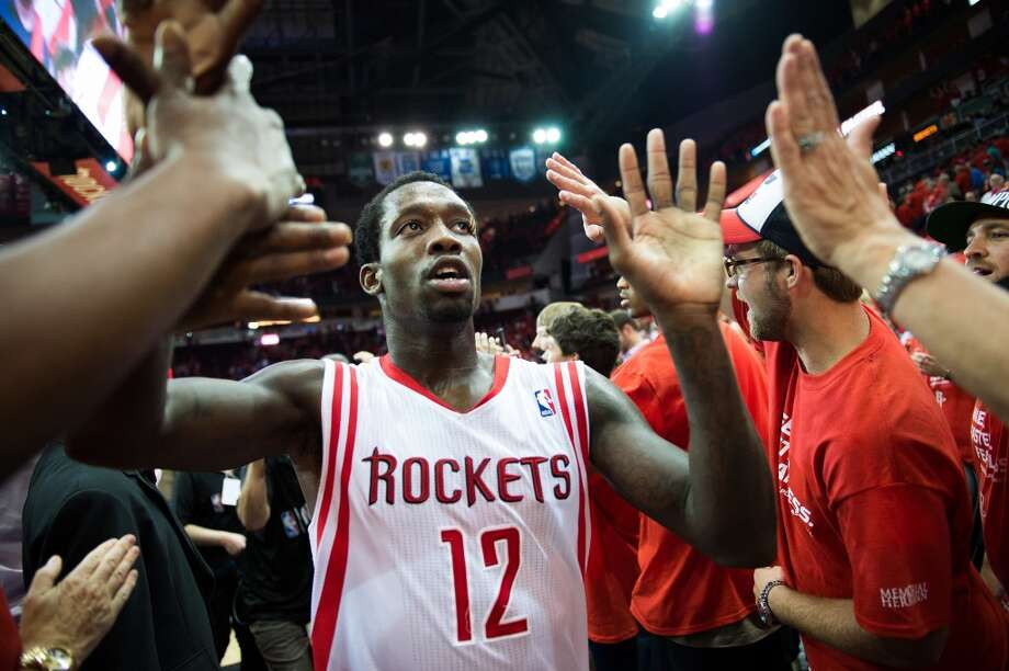 Rockets guard Patrick Beverley celebrates with fans after the game.