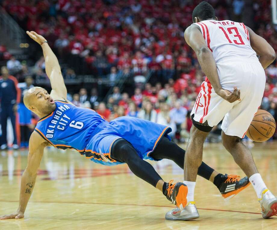 Derek Fisher of the Thunder falls to the floor after fouling Rockets shooting guard James Harden.