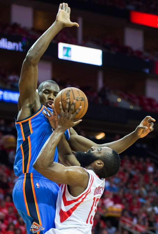 Rockets shooting guard James Harden is fouled by Thunder forward Serge Ibaka.