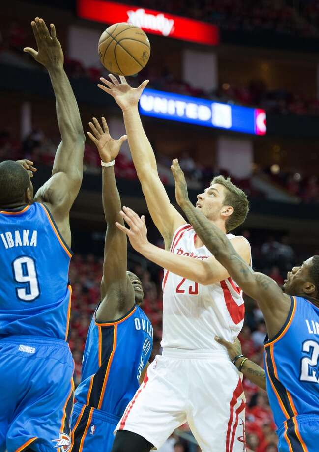 Rockets forward Chandler Parsons draws attention from a trio of Thunder players as he drives during the first half of Game 4. Parsons led the Rockets with 27 points.