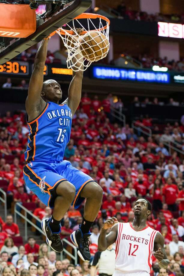 Thunder point guard Reggie Jackson dunks past  Patrick Beverley.