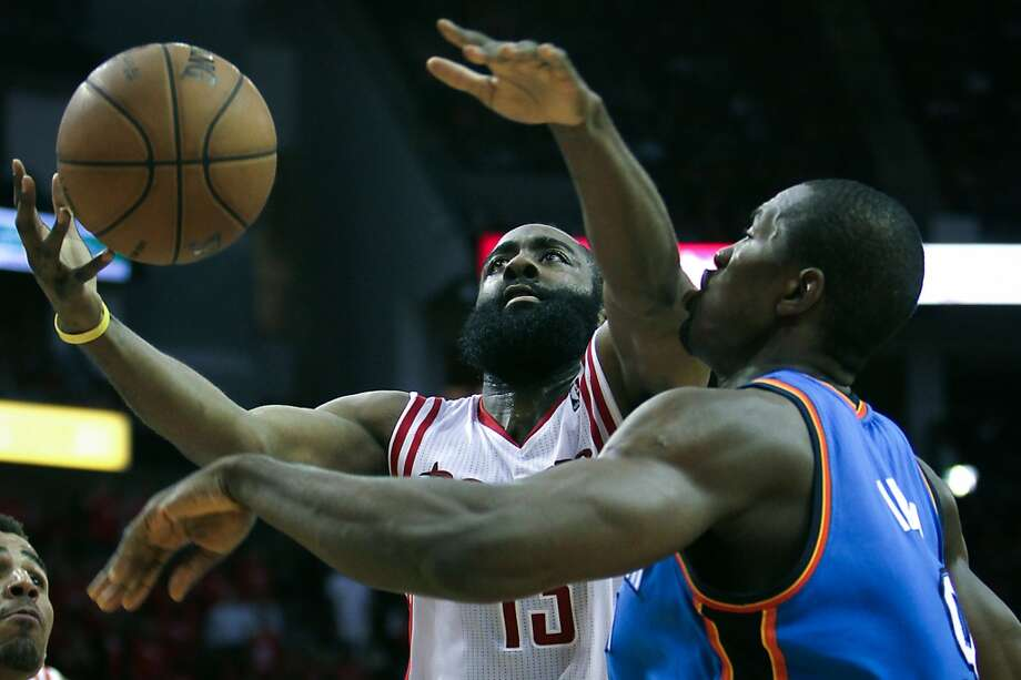 Rockets guard James Harden drives to the basket past the Thunder power forward Serge Ibaka.