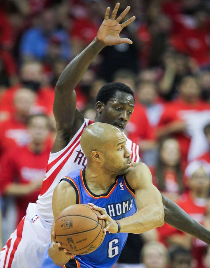 Rockets point guard Patrick Beverley defends Thunder point guard Derek Fisher.