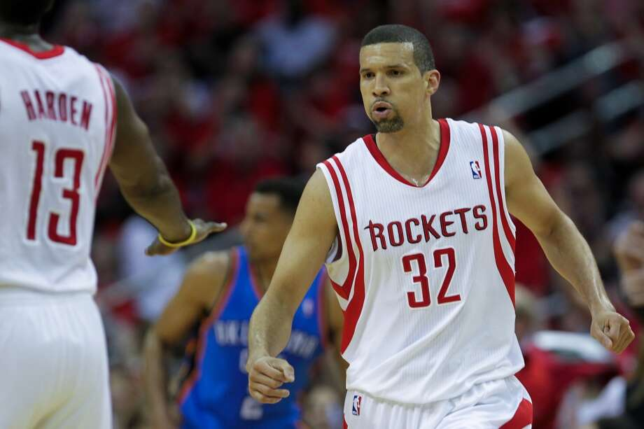 Rockets forward Francisco Garcia receives congratulations from James Harden after making a 3-pointer.