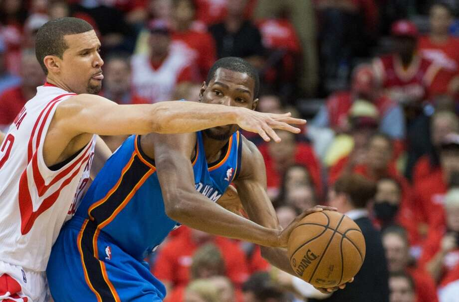 Francisco Garcia of the Rockets defends Thunder forward Kevin Durant.