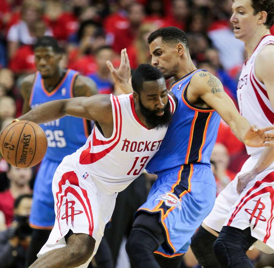 Thabo Sefolosha of the Thunder defends Rockets shooting guard James Harden.