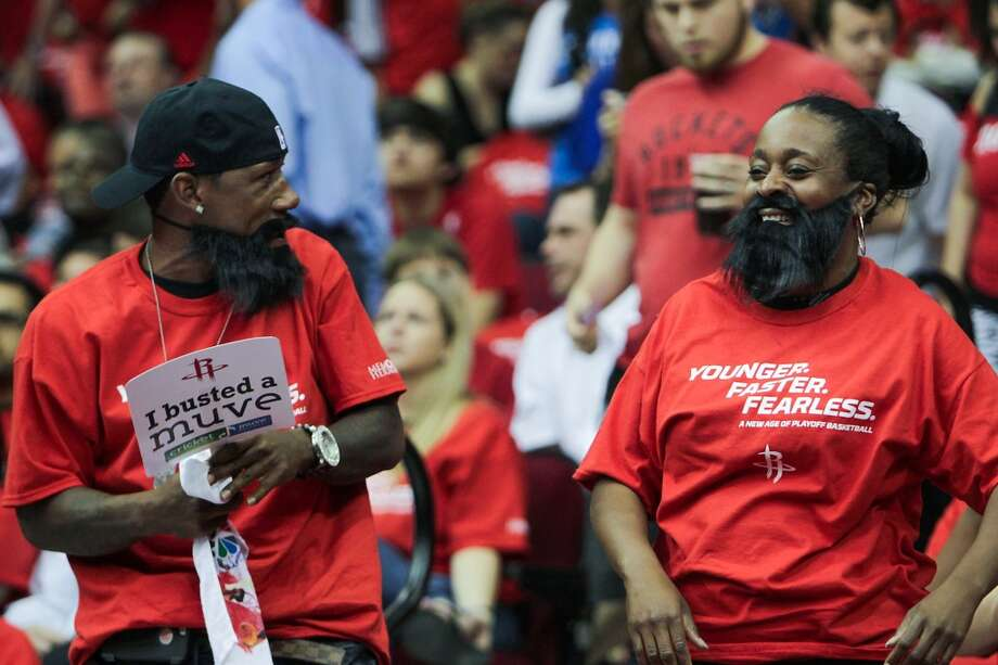 Fans wear beards and t-shirts which were given out to fans at Game 4.