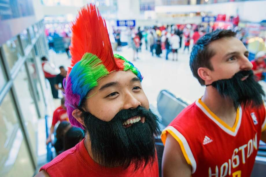 Houston Rockets fans Van Nguyen, left, and Jack Simiskey wear give-away James Harden beards as they arrive at the arena for Game 4.