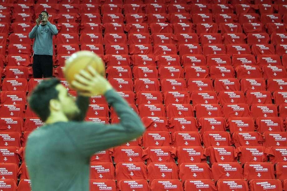 Rockets guard Carlos Delfino sharpens his stroke in the near-empty arena prior to Game 4.